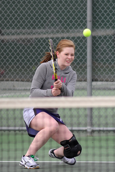 Mountain View High School's Kelci Mueller hits a backhand during her No. 2 singles match against Loveland's Sarah Klinkenbeard on Wednesday, March 20, 2013 at LHS.