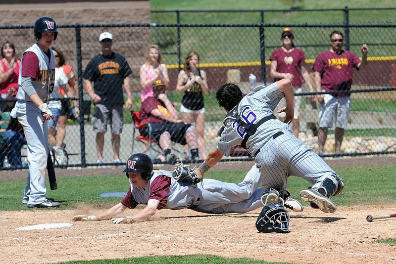 Mountain View High School catcher Dakotah Shea-Shelley tags out Windsor's Stephen Wheeler at home plate in the bottom of the sixth inning of their game on Friday, May 17, 2013 at Cherokee Trail High School in Aurora, Colo.