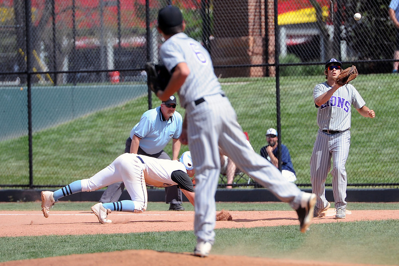 Mountain View High School pitcher Adam Baumann throws to first baseman Hunter Porterfield in a pickoff attempt in the bottom of the second inning of their game against Pueblo West on Friday, May 24, 2013 at All-Star Park in Lakewood, Colo.