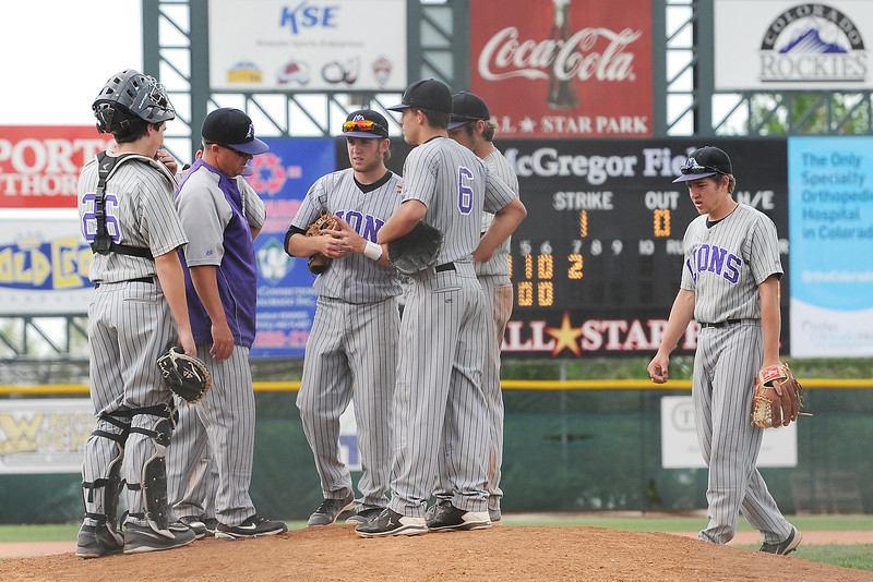 Mountain View High School baseball players talk at the mound in the bottom of the seventh inning of a game against Pueblo West on Friday, May 24, 2013 at All-Star Park in Lakewood, Colo.