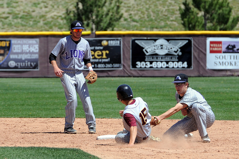 Mountain View High School second baseman Jerrod Klug, right, tags out the baserunner while shortstop Max Moree looks on in the bottom of the sixth inning of a game against Windsor on Friday, May 17, 2013 at Cherokee Trail High School in Aurora, Colo.