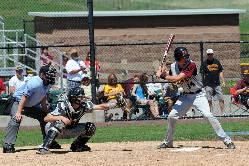 Mountain View High School catcher Dakotah Shea-Shelley works behind the plate in the bottom of the fifth inning of a game against Windsor on Friday, May 17, 2013 at Cherokee Trail High School in Aurora, Colo.