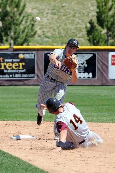 Mountain View High School second baseman Jerrod Klug throws to first base to complete a double play at the bottom of the fifth inning of a game against Windsor on Friday, May 17, 2013 at Cherokee Trail High School in Aurora, Colo.