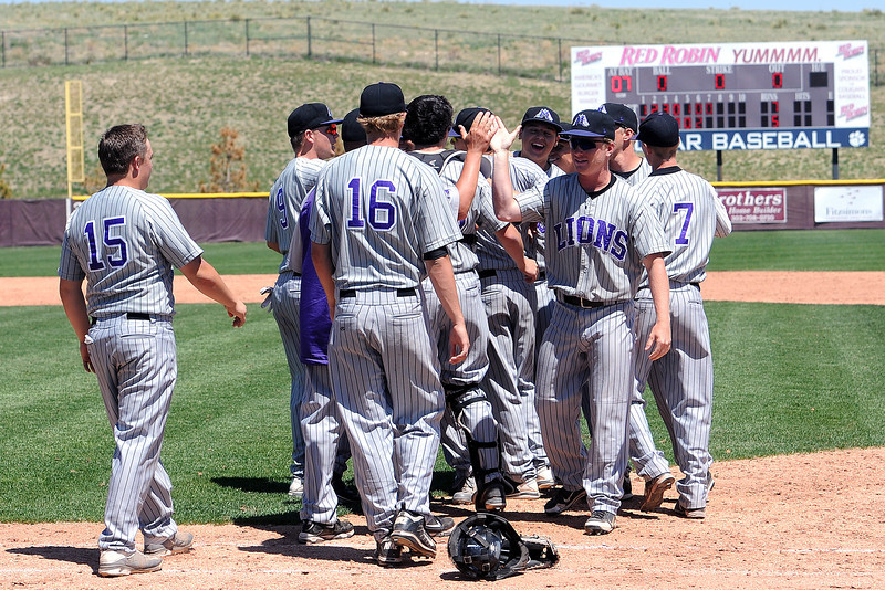 Mountain View High School baseball players and coaches celebrate after defeating Windsor on Friday, May 17, 2013 at Cherokee Trail High School in Aurora, Colo.
