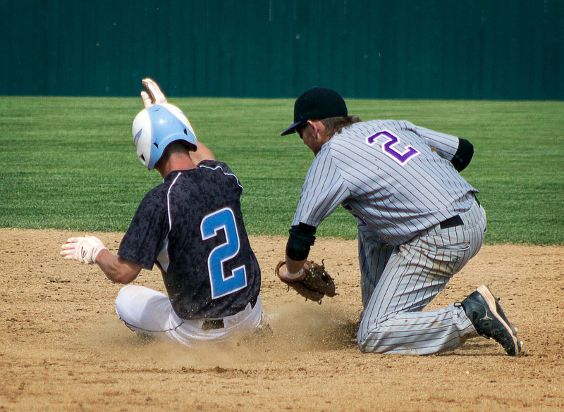 Pueblo West's Chase Trujillo, left, is tagged out at second by Mountain View's Max Moree during the Colorado State High School 4A Championship game, played May 25, 2013, in Denver, Colo. (Photo by Timothy Hurst)