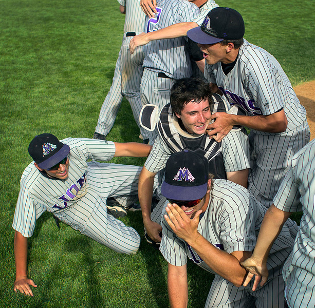 Mountain View baseball players pile onto each other after sealing a win in the Colorado State High School 4A Championship game, May 25, 2013, in Denver, Colo. Mountain View was the 28th seeded team coming into the tournament, but critical plays carried them all the way to the championship. (Photo by Timothy Hurst)