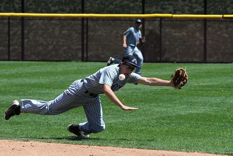 Mountain View High School second baseman Jerrod Klug makes a diving attempt at a ball hit in the bottom of the fifth inning of a game against Windsor on Friday, May 17, 2013 at Cherokee Trail High School in Aurora, Colo.