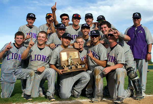 Mountain View High School varsity baseball players pose for pictures while holding the 2013 Class 4A State Championship trophy after beating top-seeded Pueblo West, May 25, 2013, in Denver, Colo. Mountain View entered the tournament as the 27th seed of 32 total spots. (Photo by Timothy Hurst)