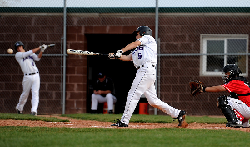 Mountain View High School senior Skyler Christensen, center, makes contact during the third inning of a game played at MVHS, Monday evening in Loveland, Colo.
