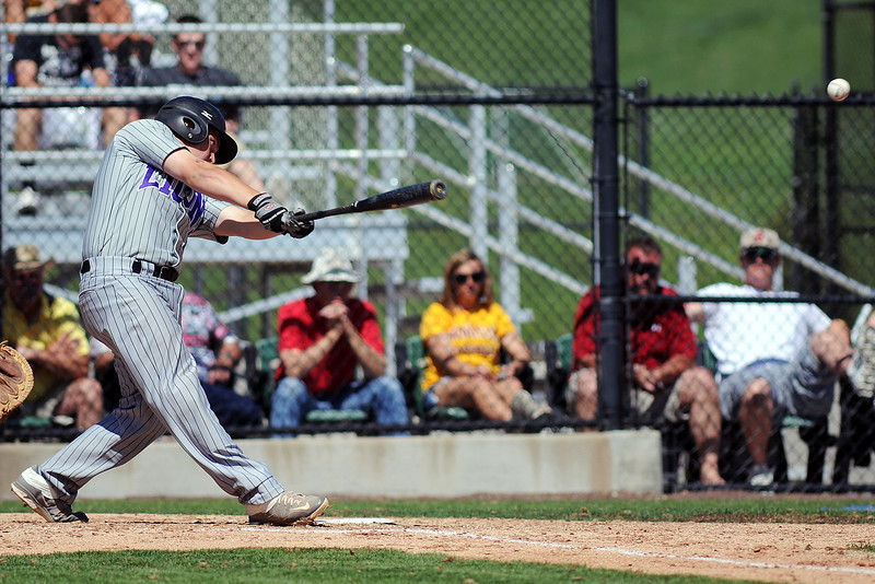 Mountain View High School sophomore Ozzie Pearcy hits a single in the top of the second inning of a game against Windsor on Friday, May 17, 2013 at Cherokee Trail High School in Aurora, Colo.