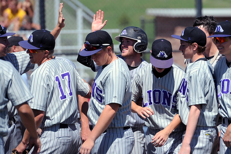 Mountain View High School's Max Moree, middle back, is congratulated at home plate by teammates after hitting a 2-run home run in the top of the third inning of a game against Windsor on Friday, May 17, 2013 at Cherokee Trail High School in Aurora, Colo.