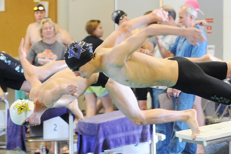 Mountain View High School's Colton Kasper, right, and Thompson Valley's CT Bosse dive in at the start of a 50-yard freestyle heat during preliminaries for the Northern Conference meet on Friday, May 10, 2013 at the Mountain View Aquatic Center.