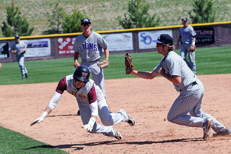 Mountain View High School first baseman Hunter Porterfield, right, tags out Windsor baserunner Lance Cox on a run down in the bottom of the fourth inning of their game on Friday, May 17, 2013 at Cherokee Trail High School in Aurora, Colo.