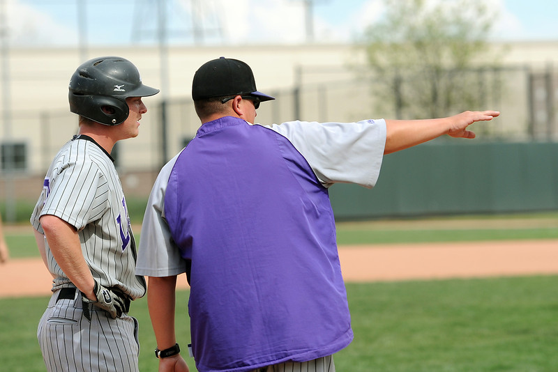 Mountain View High School's Thomas McDaniel, left, talks to head coach Brian Smela at third base during their game against Pueblo West on Friday, May 24, 2013 at All-Star Park in Lakewood, Colo.