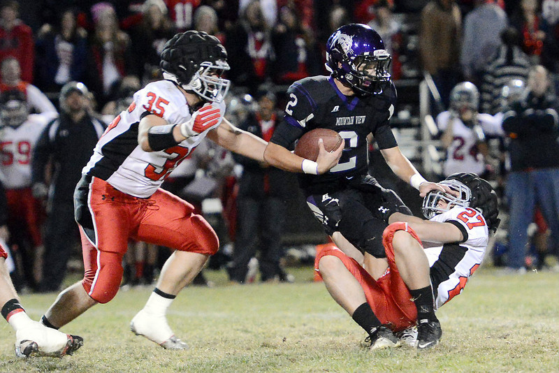 Mountain View High School quarterback Adam Baumann (2) is sacked  by Loveland defenders Kris Garcia (35) and Josh Ouimet (27) in the second quarter of their game on Friday, Nov. 2, 2012 at Patterson Stadium.