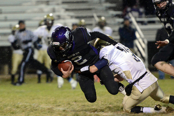 Mountain View High School quarterback Adam Baumann (2) is tackled by Greeley West defender Andrew Brunning in the second quarter of their game Thursday, Oct. 25, 2012 at Patterson Stadium.