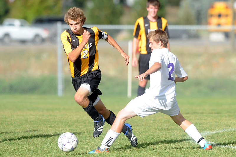 Thompson Valley High School's Nash Doughman, left, and Mountain View's Reece Christensen go after the ball in the first half of their match on Wednesday, Oct. 3, 2012 at MVHS.