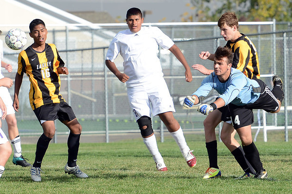 Mountain View High School goalie Roberto Nicotra, right, punches the ball away for a save in the first half of a match against Thompson Valley on Wednesday, Oct. 3, 2012 at MVHS.