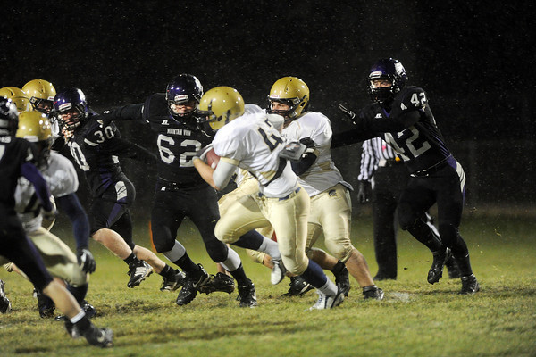 Loveland High School defenders Michael Mansfield (30) Taylor Woodward (62) and Thomas McDaniel (42) pursue Greeley West running back David Eddy, middle, in the first quarter of their game Thursday, Oct. 25, 2012 at Patterson Stadium.