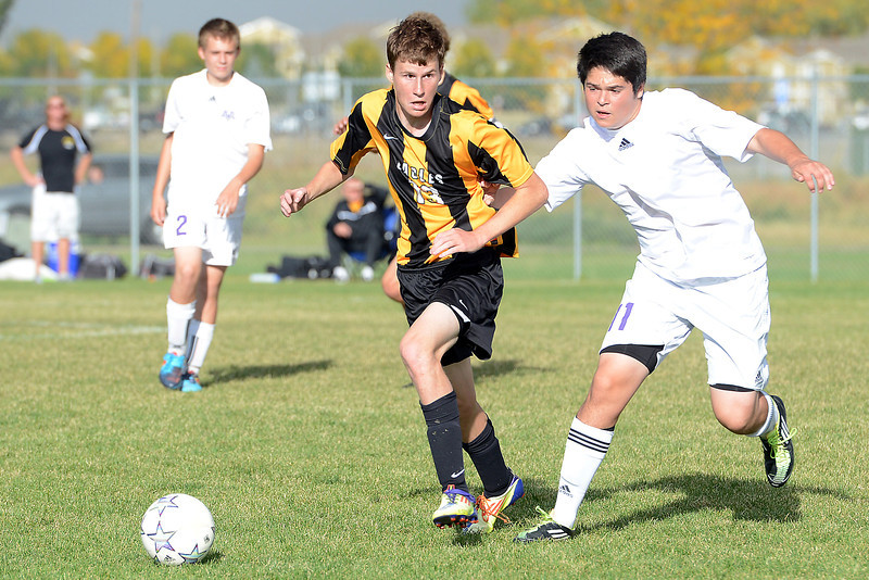 Mountain View High School's Jose Perez, right, and Thompson Valley's Joe Dennis track down the ball in the first half of their match on Wednesday, Oct. 3, 2012 at MVHS.