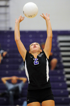 Mountain View High School's Katelyn Waddell sets the ball during a match against Broomfield on Tuesday, Sept. 11, 2012 at MVHS.