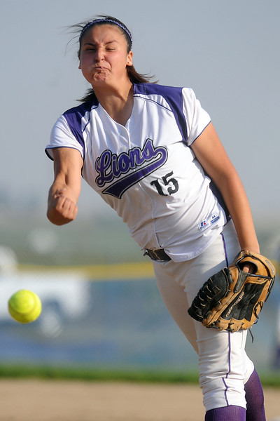 Mountain View High School junior Mia Trujillo throws a pitch in the top of the second inning of a game against Thompson Valley on Tuesday, Sept. 18, 2012 at MVHS.