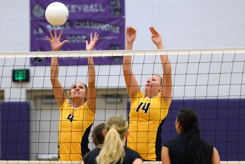 Thompson Valley High School's Nicole Wilson (4) and Taylor Moran (14) go up at the net against Mountain View players, from left to right, Katelyn Waddell, Kaitlin Miller and Ashley Carrera during set one of their match on Thursday, Sept. 27, 2012 at MVHS.