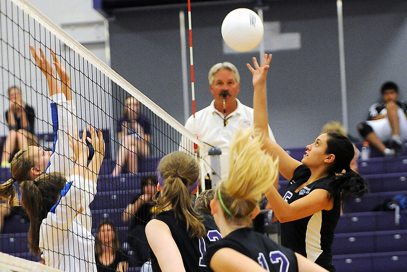 Mountain View High School's Ashley Carrera, back right, goes up for the ball during set two of a match against Broomfield on Tuesday, Sept. 11, 2012 at MVHS.