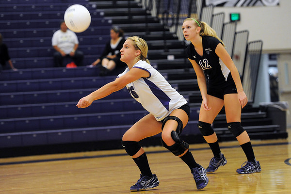 Mountain View High School's Rosie Cloutier, left, returns a shot while teammate Kaitlin Miller looks on during their match against Broomfield on Tuesday, Sept. 11, 2012 at MVHS.