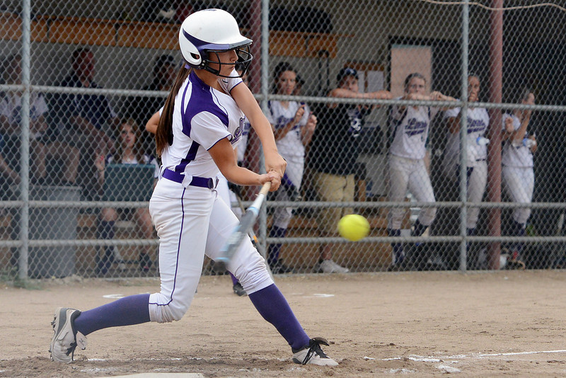 Mountain View High School's Madi Harrison hits a double in the bottom of the second inning of a game against Niwot on Tuesday, Sept. 11, 2012 at MVHS.