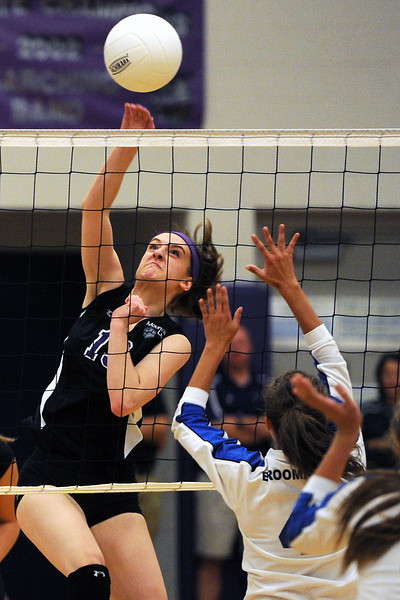 Mountain View High School's Katie Hanson spikes the ball during set one of a match against Broomfield on Tuesday, Sept. 11, 2012 at MVHS.