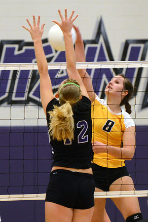 Thompson Valley High School's Paige Daniels, right, attempts a spike over Mountain View's Kaitlin Miller during set one of their match Thursday, Sept. 27, 2012 at MVHS.