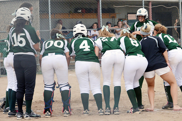 Niwot High School's Jessica Johnson, back right, is greeted by teammates at home plate after hitting a 3-run home run in the top of the sixth inning of a game against Mountain View on Tuesday, Sept. 11, 2012 at MVHS.