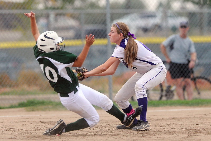 Niwot High School's Brooklynn DeLozier slides safely into second base ahead of the tag by Mountain View shortstop Gianna Melargno in the top of the second inning of their game Tuesday, Sept. 11, 2012 at MVHS.