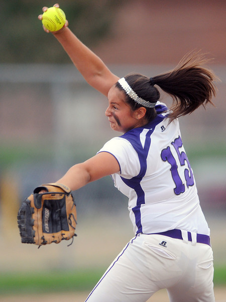 Mountain View High School's Mia Trujillo winds up before throwing a pitch in the top of the third inning of a game against Niwot on Tuesday, Sept. 11, 2012 at MVHS.