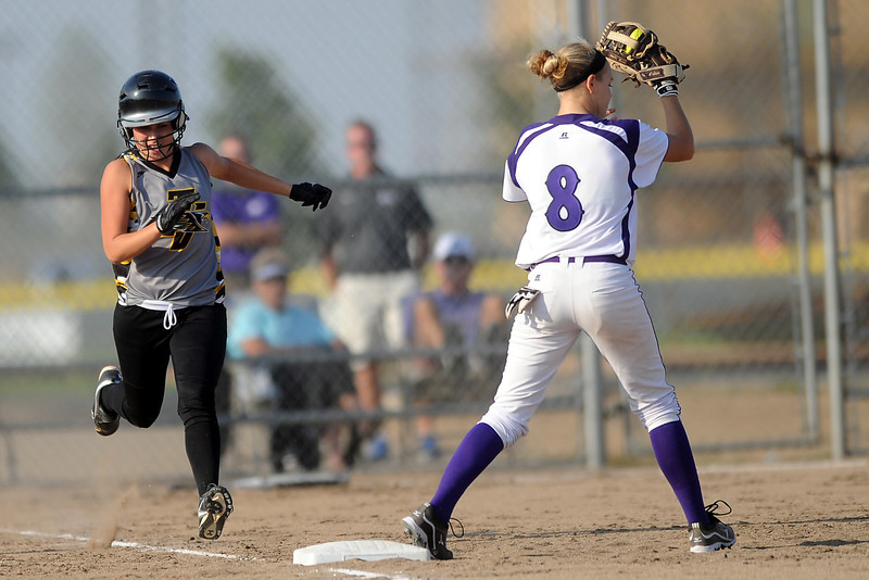 Mountain View High School first baseman Courtney Baeckel (8) gets a force out of Thompson Valley's Karli Kramer in the top of the fifth inning of their game on Tuesday, Sept. 18, 2012 at MVHS.