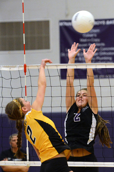 Thompson Valley High School's Katie Beard, right, attempts a spike over Mountain View's Katelyn Waddell during set one of their match Thursday, Sept. 27, 2012 at MVHS.