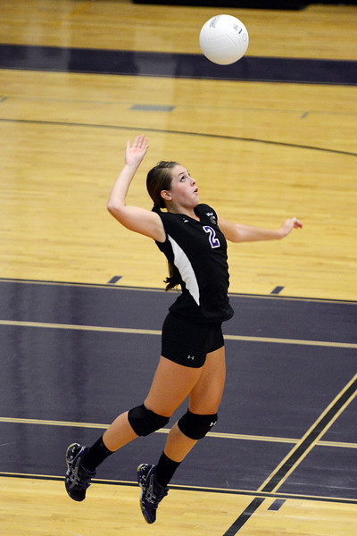 Mountain View High School's Katelyn Waddell goes up for a serve during set one of a match against Thompson Valley on Thursday, Sept. 27, 2012 at MVHS.