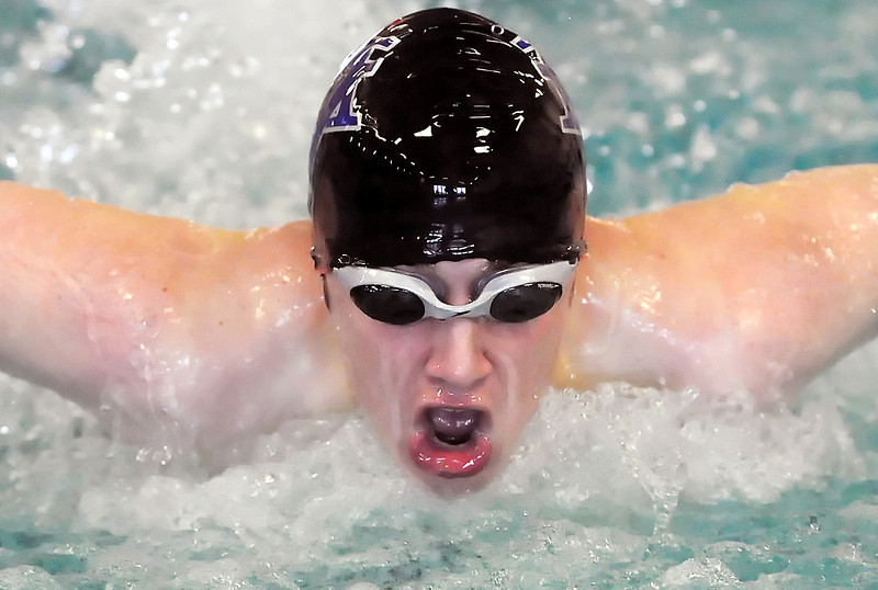 Mountain View High School junior Jake Ores swims in the 100-yard butterfly during the Loveland City Meet on Tuesday, April 20, 2010 at the Moutain View Aquatic Center.