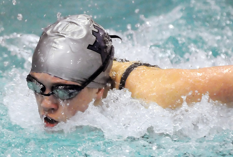 Mountain View High School junior Jessica Reed-Baum swims in a heat of the 100-yard butterfly during the Class 4A State Swim and Dive Championships at the Mountain View Aquatic Center on Friday.
