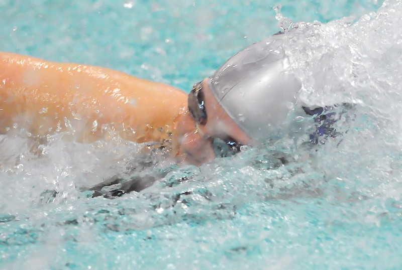 Mountain View High School senior Anna Krajec swims in a heat of the 100-yard freestyle during the Class 4A State Swim and Dive Championships at the Mountain View Aquatic Center on Friday.
