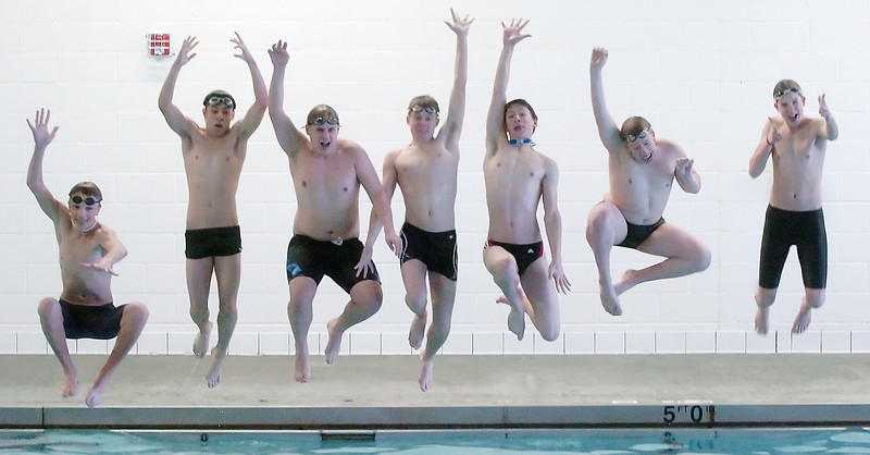 Members of Mountain View High School leap into the pool Thursday.