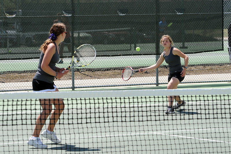 Mountain View High School's Tiffany Filler, right, returns a shot while her No. 4 doubles partner Staley Morgan looks on during the Northern Colorado Invitational on Friday, April 13, 2012 at Loveland High School.