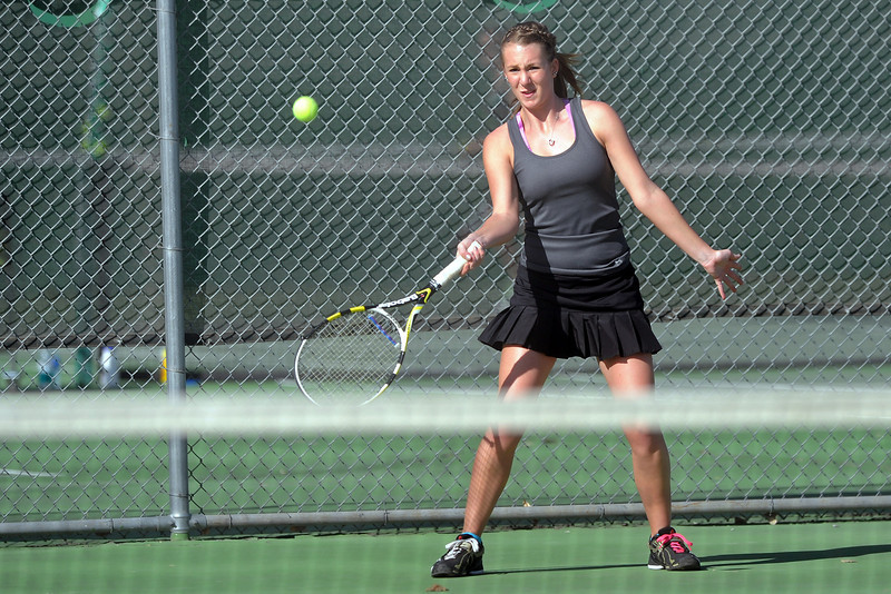 Mountain View High School's Jordan Holland returns a shot during her No. 1 singles match against Loveland's Jen Weissmann on Thursday, March 15, 2012 at LHS.