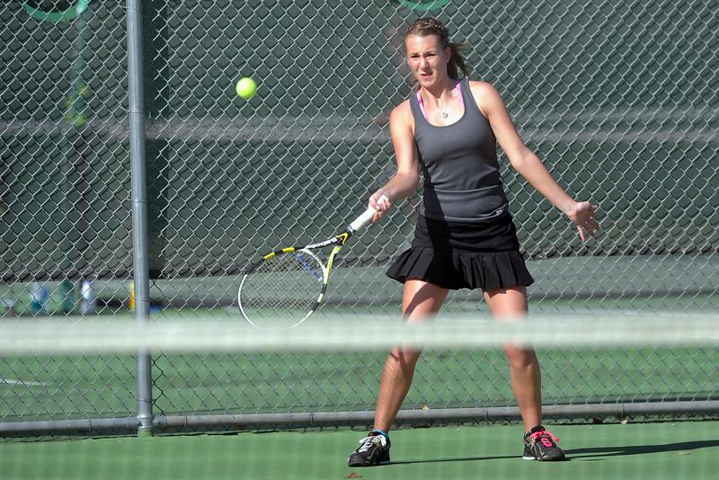 Mountain View High School's Jordan Holland returns a shot during her No. 1 singles match against Loveland's Jen Weissmann on Thursday, March 15, 2012 at LHS.