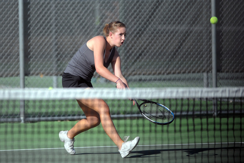 Mountain View High School's Danielle Sheffler hits a backhand during her No. 2 singles match against Loveland's Jordan Paulus on Thursday, March 15, 2012 at LHS.