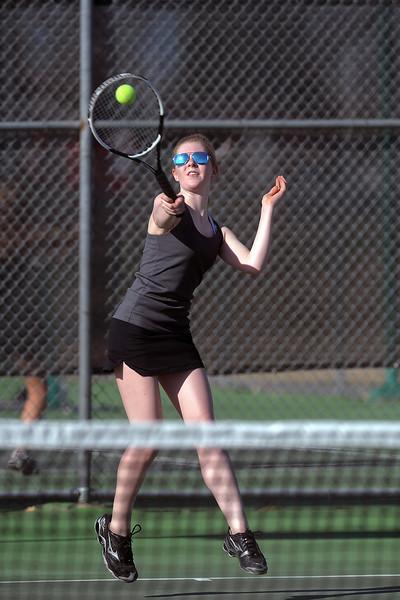Mountain View High School's Kelci Mueller strikes a forehand during her No. 3 singles match against Loveland's Maddie Winn-Clouse on Thursday, March 15, 2012 at LHS. Mueller won the match