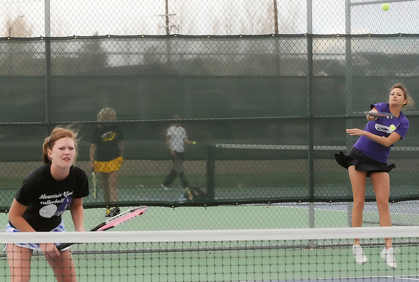 Mountain View High School's Devyn Mueller, 17, left, plays net while her No. 1 doubles teammate Aubree Bullock, 17, hits a serve during their match against Thompson Valey's Alison Donelan and Shannon Galligan on Monday at the MVHS tennis courts.