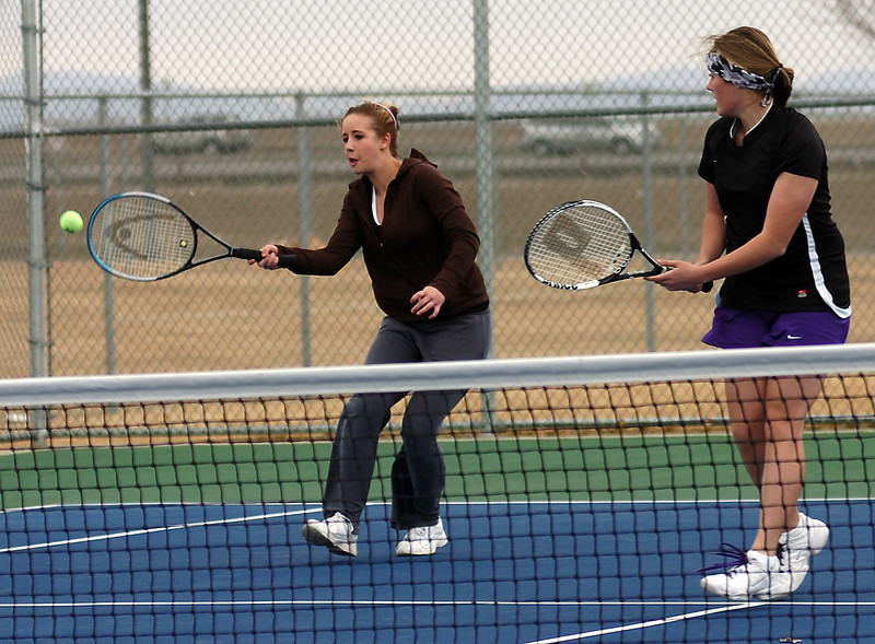 Mountain View #4 doubles team Danielle Sheffler, left, and Paige Primmer play against Loveland's Casey Kleeman and Chichi Wang.