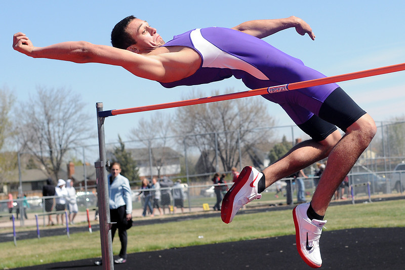 Mountain View High School senior Josh Dyekman clears the bar at 5 feet, 10 inches to win the high jump Friday during the R2-J Invitational at the Loveland High School track.